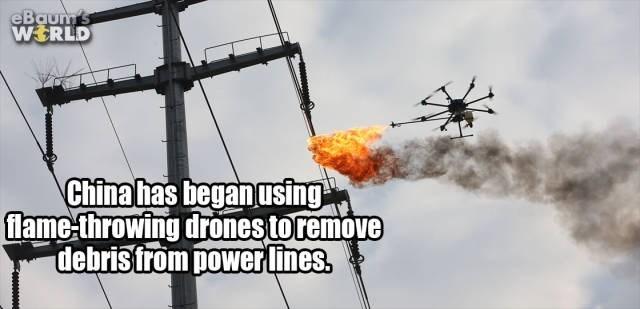 Vehicle - eBaun 's WERLD China has began using flame-throwing drones toremove debristrom power lines.