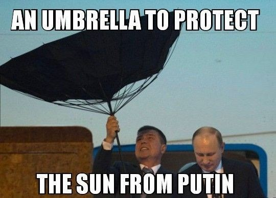 Photo caption - AN UMBRELLA TO PROTECT THE SUN FROM PUTIN
