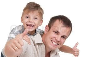 Child and man doing thumbs up