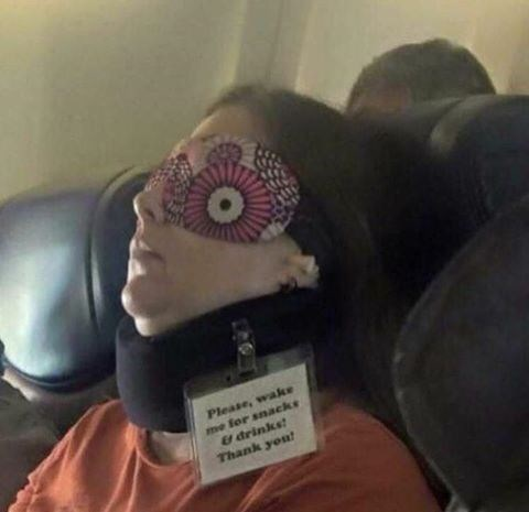 Thrusday meme with pic of woman sleeping on plane with a note asking to wake her for snacks