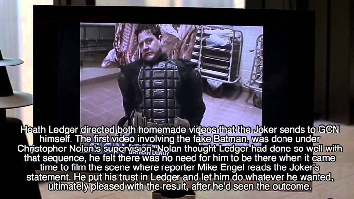 Text - Heath Ledger directed both homemade videos that the Joker sends to GCN himself. The first video involving the fake Batman, was done under Christopher Nolan's supervisionNolan thought Ledger had done so well with that sequence, he felt there was no need for him to be there when it came time to film the scene where reporter Mike Engel reads the Joker's statement. He put his trust in Ledger and let him do whatever he wanted, ultimately pleased with the result, after he'd seen the outcome. AN