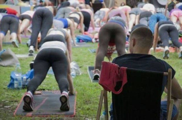man checking out women doing yoga