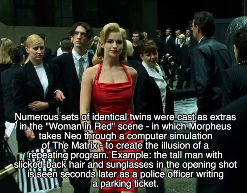 """Photo caption - Numerous sets of identical twins were cast as extras in the """"Woman in Red"""" scene - in which Morpheus takes Neo through a computer simulation of The Matrixto create the illusion of a repeating program. Example: the tall man with slicked-back hair and sunglasses in the opening shot is seen seconds later as a police officer writing a parking ticket."""