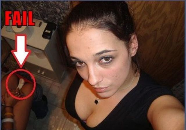girl taking selfie and another woman in the background is putting in a maxipad on the toilet.