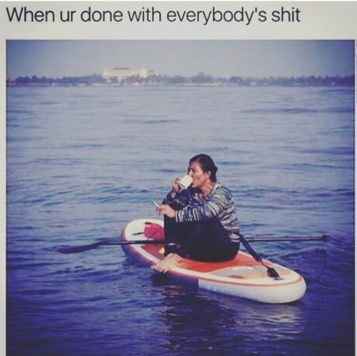 Wednesday meme about needing peace and quiet with pic of woman smoking and drinking coffee on a surfboard at sea