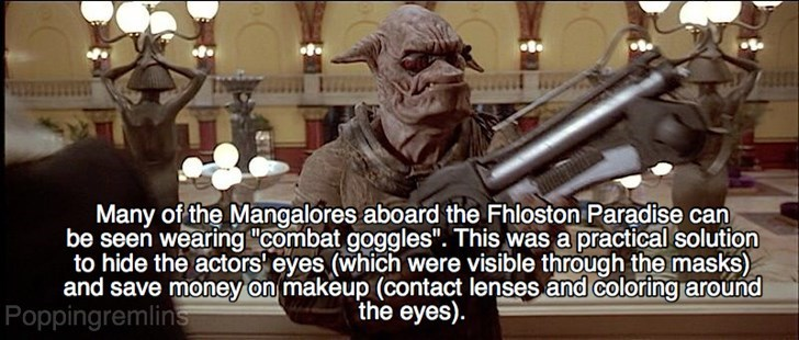 """Fictional character - Many of the Mangalores aboard the Fhloston Paradise can be seen wearing """"combat goggles"""". This was a practical solution to hide the actors eyes (which were visible through the masks) and save money on makeup (contact lenses and coloring around Poppingremlins the eyes)"""