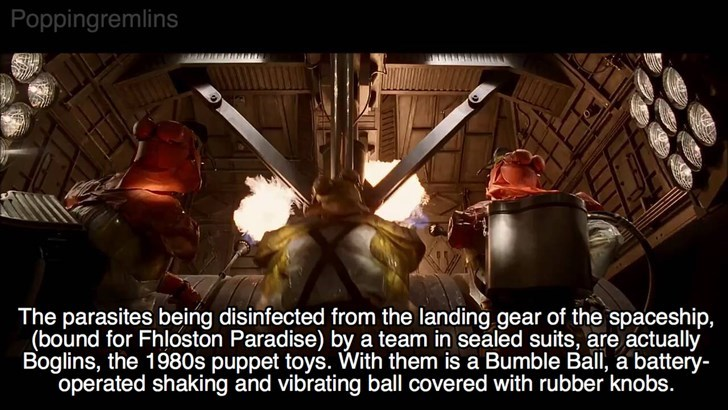 Photo caption - Poppingremlins The parasites being disinfected from the landing gear of the spaceship, (bound for Fhloston Paradise) by a team in sealed suits, are actually Boglins, the 1980s puppet toys. With them is a Bumble Ball, a battery- operated shaking and vibrating ball covered with rubber knobs.