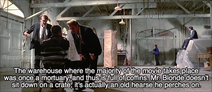 Adaptation - @poppingre lins The warehouse where the majority of the movie takes place was once a mortuary, and thus is full of coffins. Mr. Blonde doesn't sit down on a crateg it's actually an old hearse he perches on.