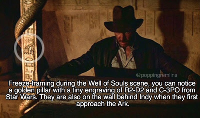 Photo caption - @poppingremlins Freeze-framing during the Well of Souls scene, you can notice a golden pillar with a tiny engraving of R2-D2 and C-3PO from Star Wars. They are also on the wall behind Indy when they first approach the Ark.