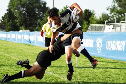 picture two rugby players tackling each other