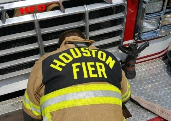 Work Meme with pic of a fire fighter wearing a misspelled vest