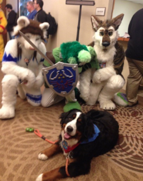 Dog next to furry con members
