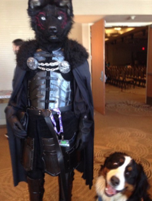 dog pic next to a furry con member