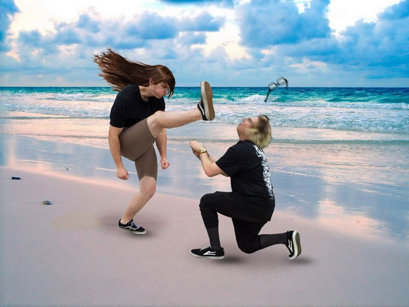 Funny picture from the mosh pit proposal of the couple on the beach kicking off the glasses and a few other funny changes.