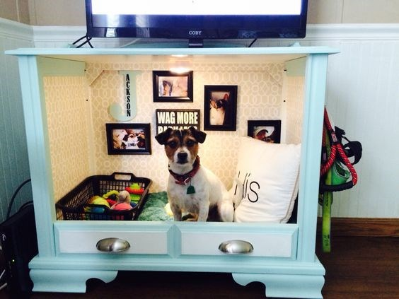 Dog bed made from a dresser that also holds the TV.