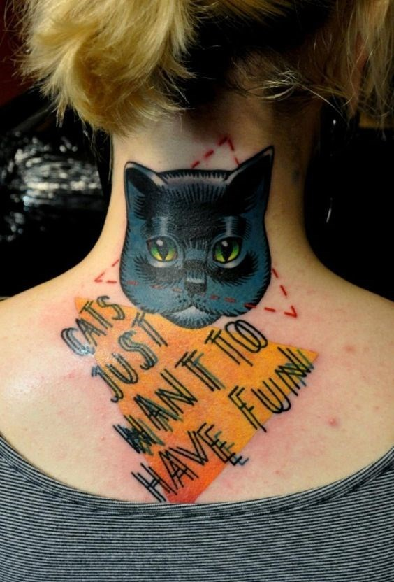 Tattoo of a cat on the back of a woman's neck.