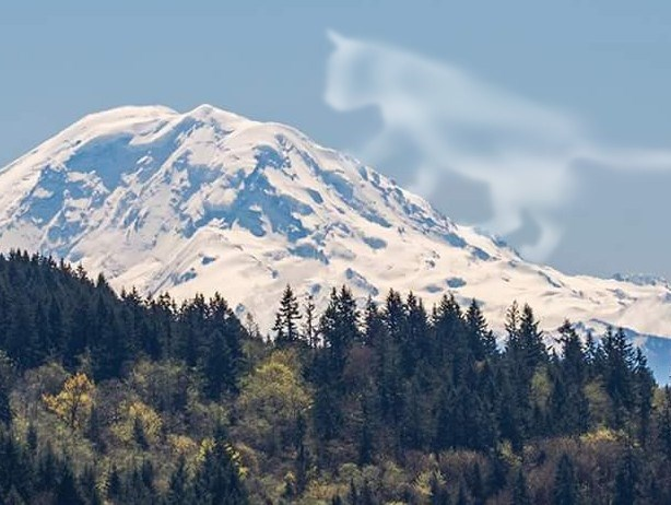 Mountain in Washington state that looks like a face, with a cloud that looks like a cat ready to wake him up