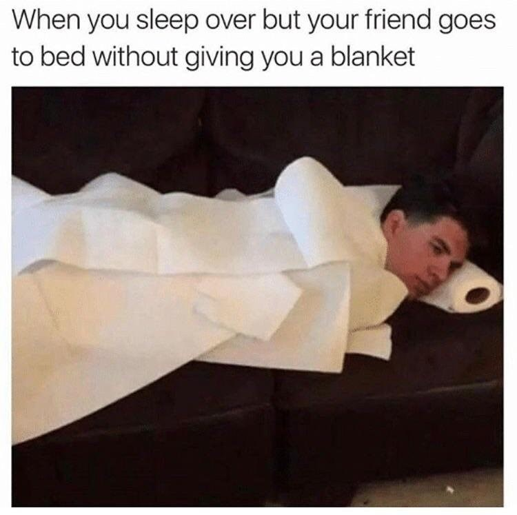 When your friend lets you sleep over but they don't give you a pillow or blanket, man sleeping on couch with paper towel roll as pillow and paper towels as blanket.