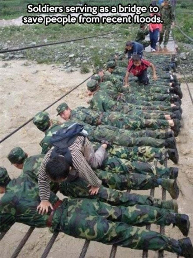 Military uniform - Soldiers serving asabridge to save people fromrecent floods.