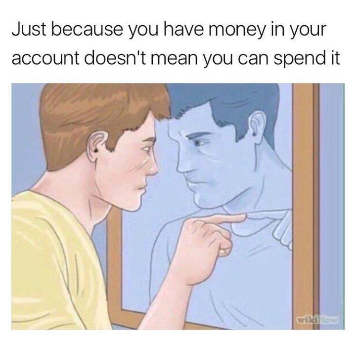 Man talking to reflection in mirror, just because you have money in your account doesn't mean you should spend it.