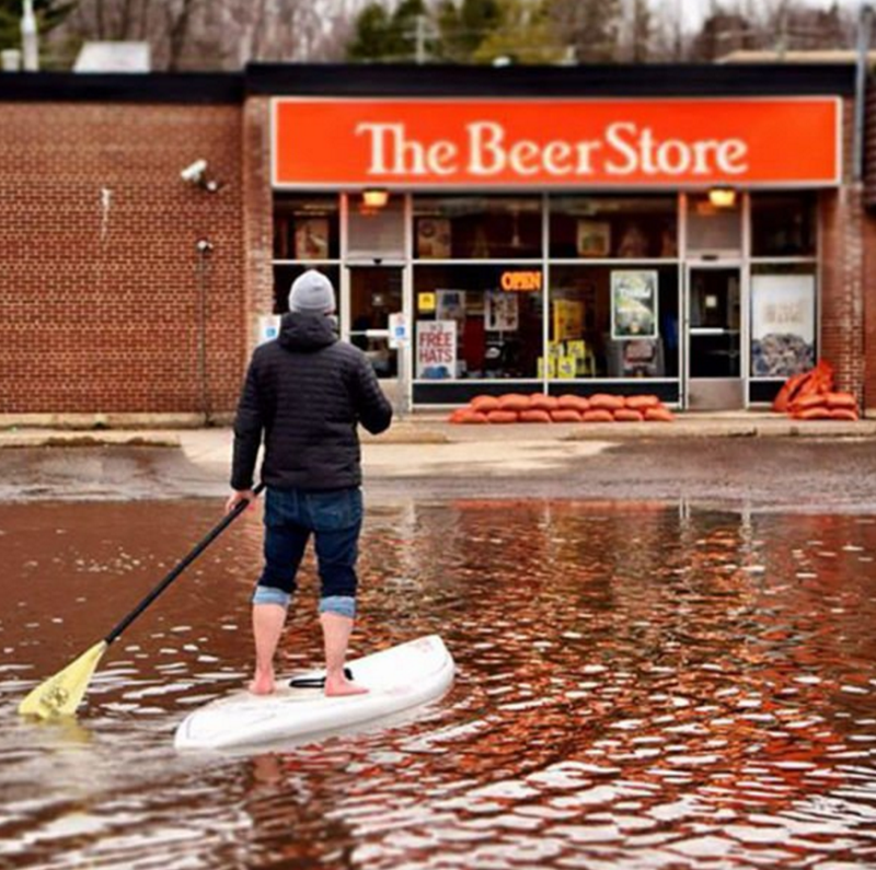 Stand up paddle surfing - The Beer Store OPEN FREE HATS