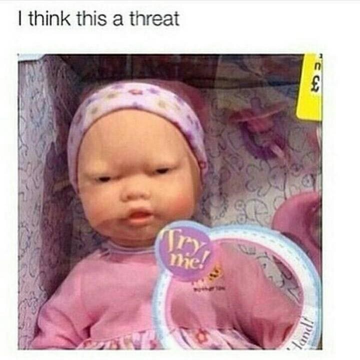 Photo of baby doll that looks like it wants to fight, caption read that they think it is a threat.
