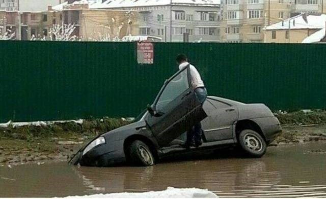 Driving FAIL Guy drives into water