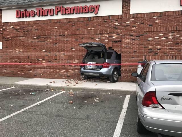 Driving FAIL person drives through drive-thru pharmacy