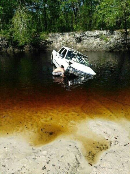Driving FAIL guy drives into pond
