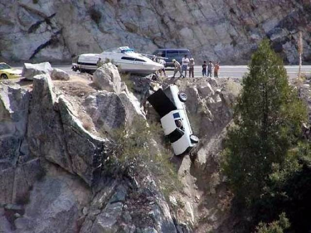 Driving FAIL truck towing a boat drives over the edge