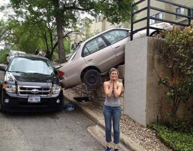 Driving FAIL girl backs over edge into another car