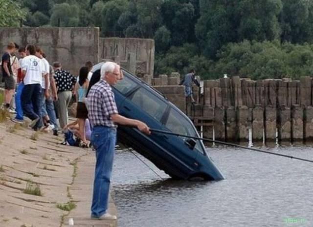 Guy fishing next to car in lake