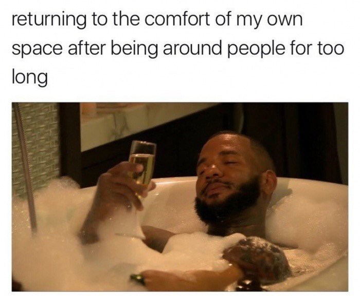 funny meme about chilling after everyone is gone - picture of bald man with beard drinking white wine in the bathtub.