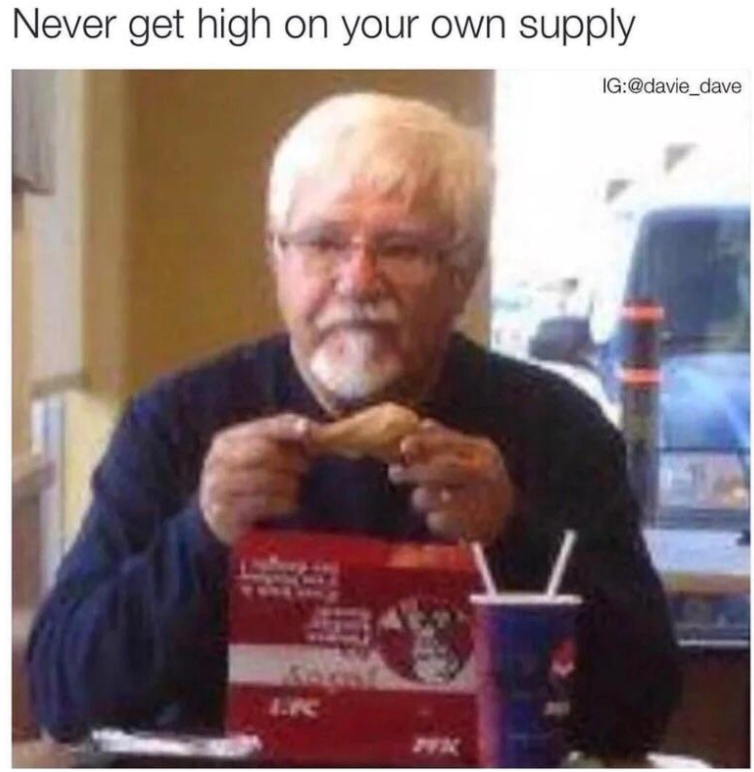 Funny meme Colonel Sanders eating chicken