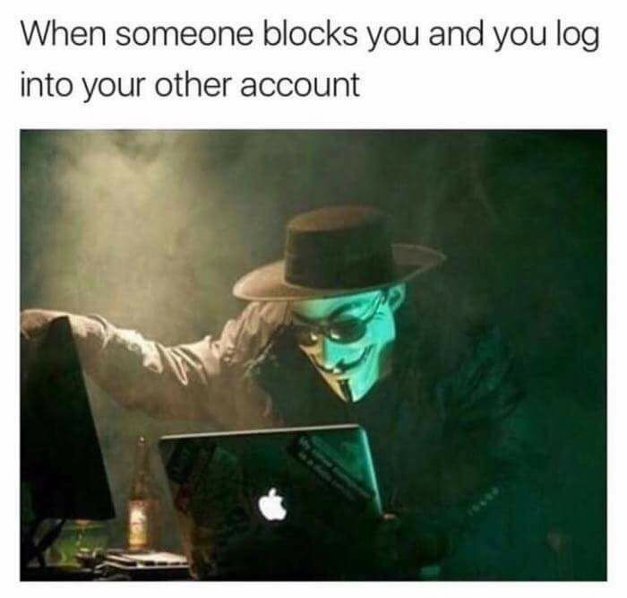Funny meme with a man in an anonymous mask describing when you get blocked but then log into your other account.