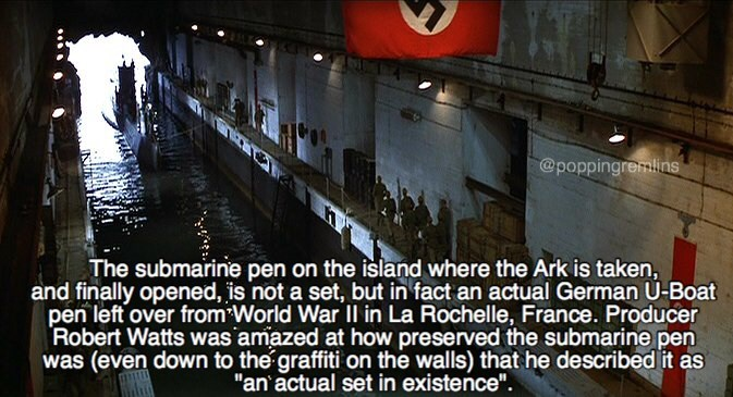 """Font - @poppingremlins The submarine pen on the island where the Ark is taken, and finally opened, is not a set, but in fact an actual German U-Boat pen left over from World War Il in La Rochelle, France. Producer Robert Watts was amazed at how preserved the submarine pen was (even down to the graffiti on the walls) that he described it as """"an actual set in existence""""."""