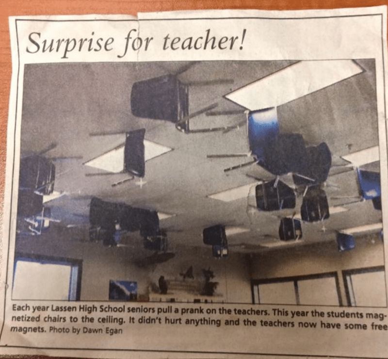 Students pull prank and magnetize chairs to ceiling.