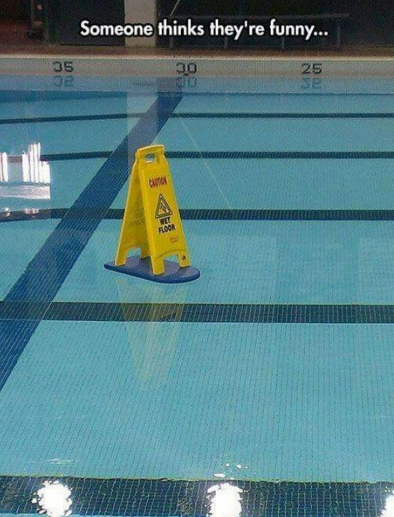 Someone put wet floor sign in pool.