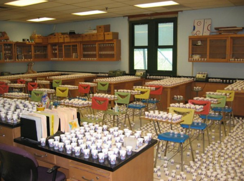 Students prank with tons of empty paper cups in classroom.