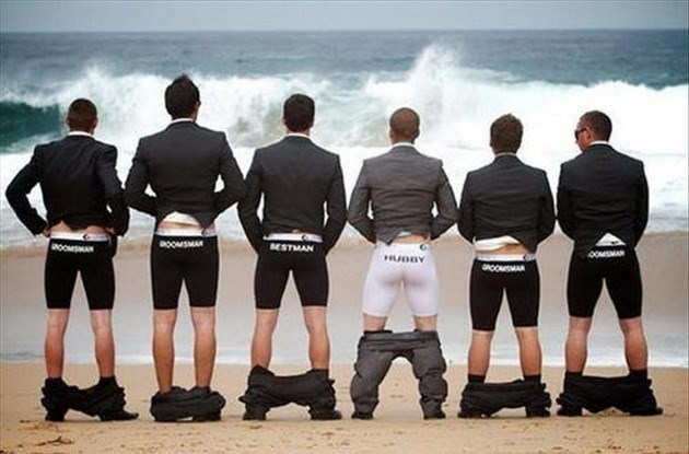 funny pic of groomsmen facing the ocean with their pants down
