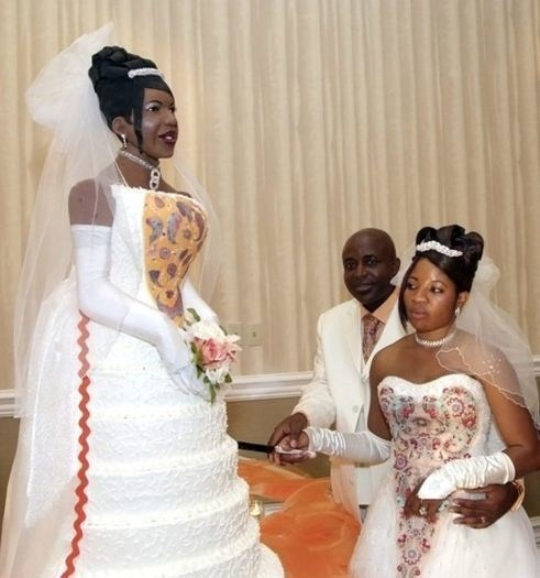 funny pic of a bride next to a life size statue of her