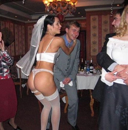 funny pic of a bride dancing in lingerie