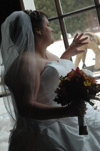 funny pic of bride looking out a window at a man's backside