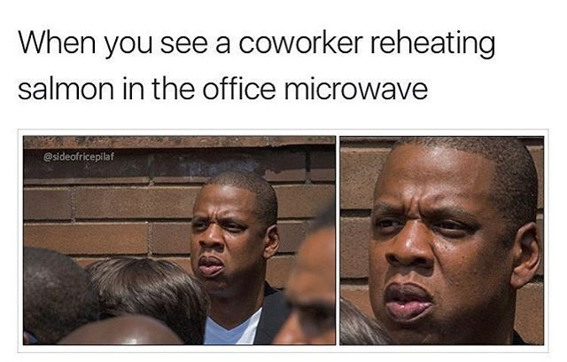 Funny meme featuring Jay-Z's face reacting to a coworker reheating salmon for lunch. Work woes.