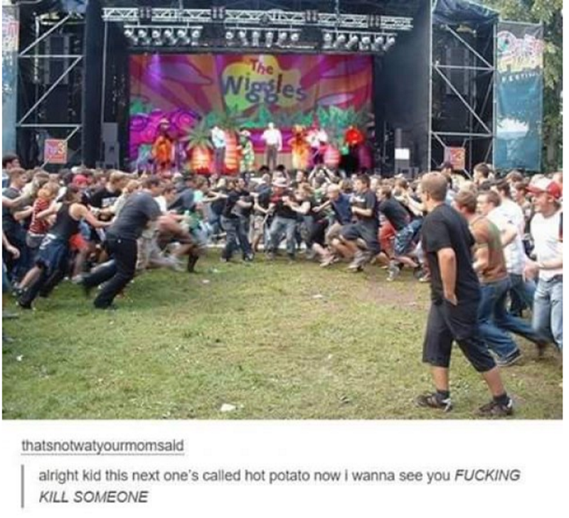 Massive brawl breaks out at outdoor concert.