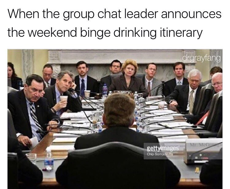 Funny meme about planning binge drinking for the weekend with a table of people in a serious meeting setting.
