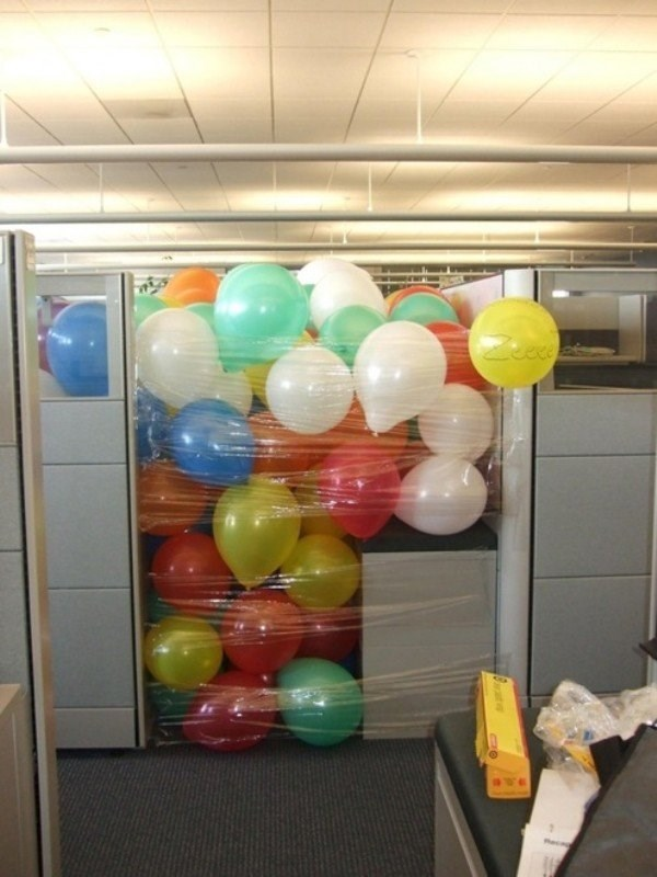 Cubicle full of balloons