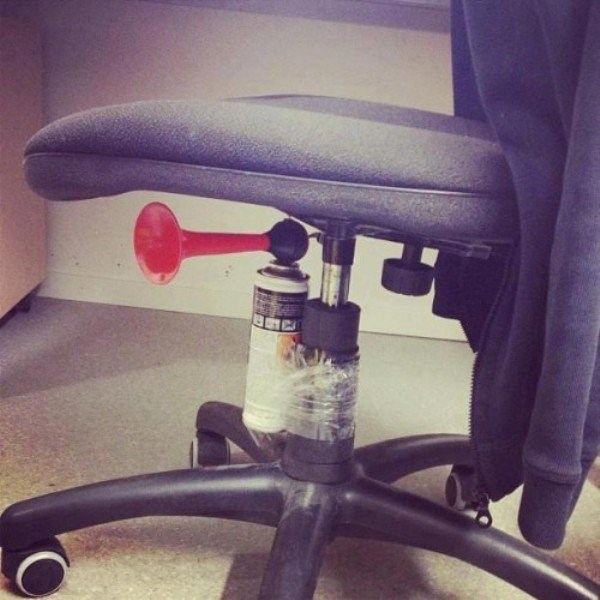fog horn affixed to the bottom of an office chair to make loud surprise prank on the person who sits on it.
