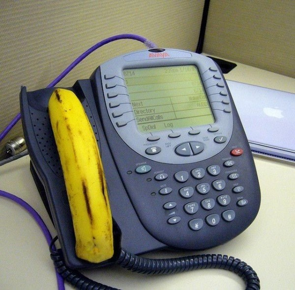 funny picture of a phone that has been pranked to have a banana for a headset.