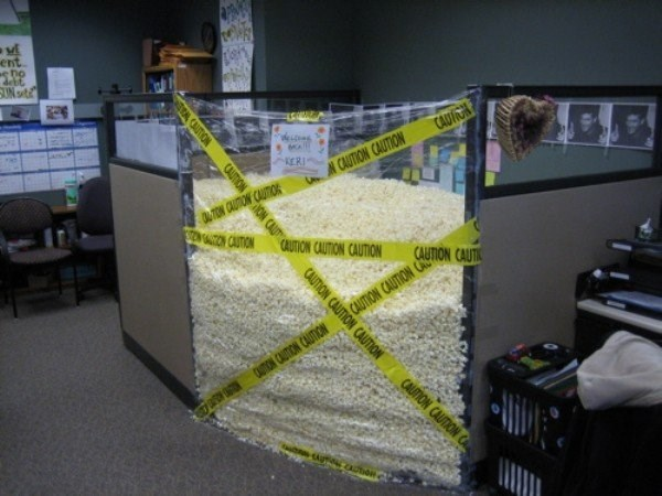 Office cubicle filled with Styrofoam peanuts.